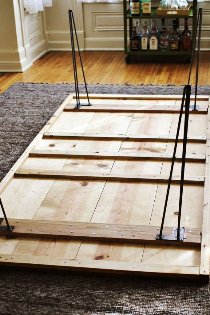 bought our lumber: 4 long planks for the top, 9 smaller planks bracing and frami...