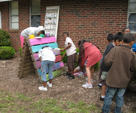 Kids in the Guerrilla Artists Youth Art Program created a garden from wood palle...
