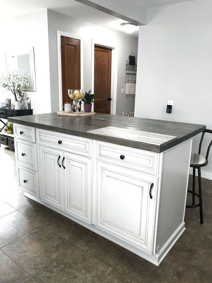 DIY Kitchen Island With Stock Cabinets. Learn how to build a kitchen island usin...