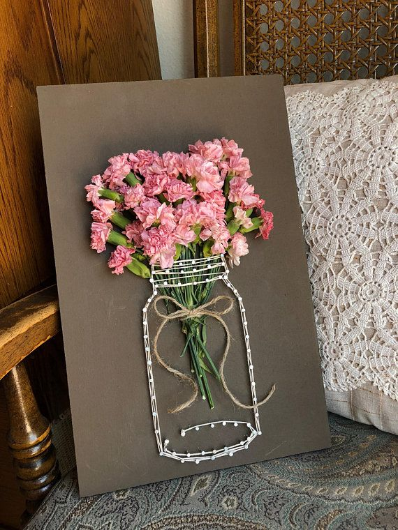This adorable string art is perfect for any floral savvy person.