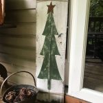 This simple rustic Christmas tree, complete with rusty stars and ties.