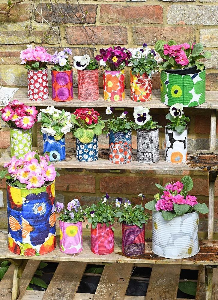 15 Cute Ways To Decorate Tin Cans Into Planters for Outdoor Container Gardens or...