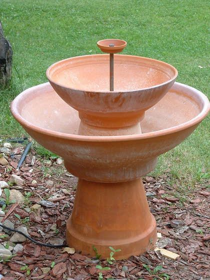 DIY terra cotta fountain... ooooh this would be so cool outside! Also great for ...