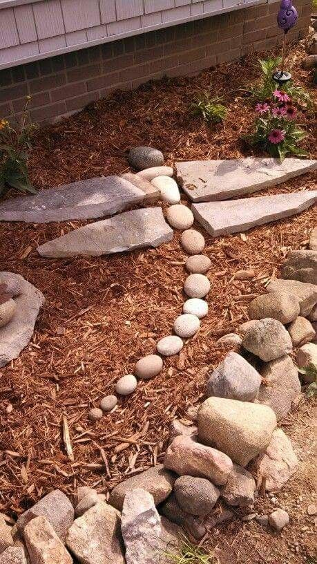 Awesome stone dragonfly! Now I have to start making some big, diamond shaped ...