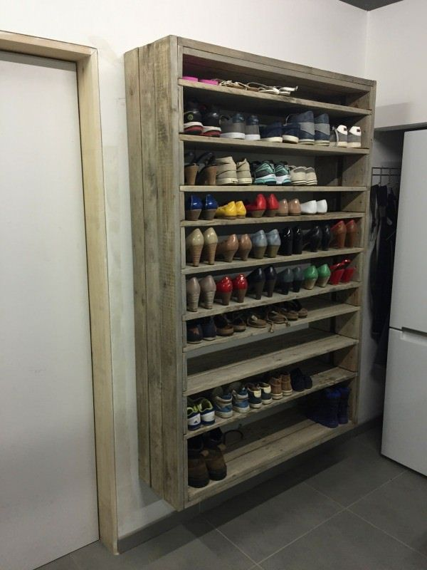 Giant Shoe Rack Made Out Of Discarded Pallets Shelves & Coat Hangers