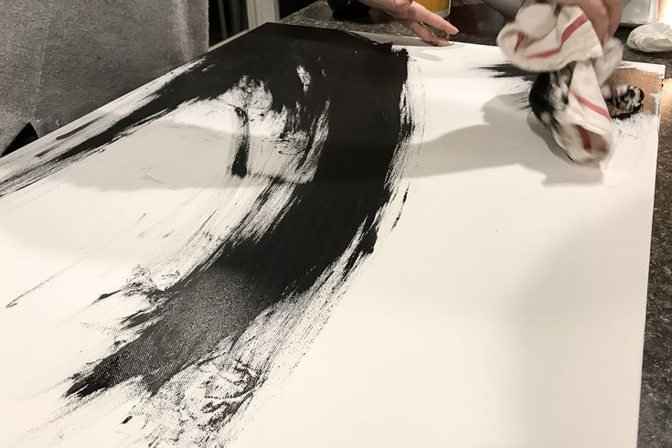 Learn how to DIY abstract canvas art with some black and white paint. This minim...