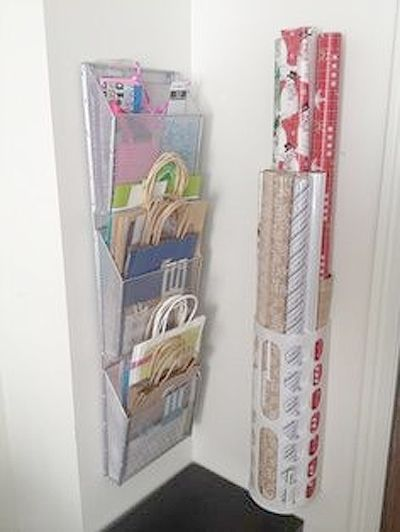 A mail organizer and a grocery bag keeper! Gift Wrap station. I want this in the...