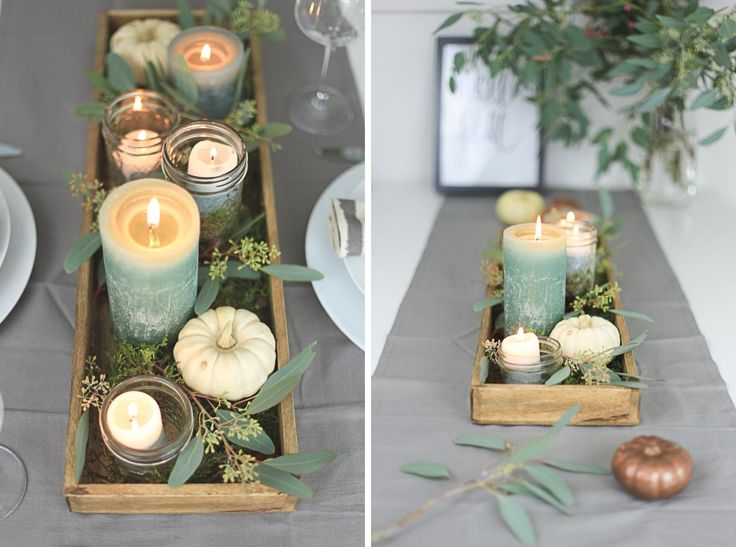 Autumn table decoration with candles, mason jars and eucalyptus
