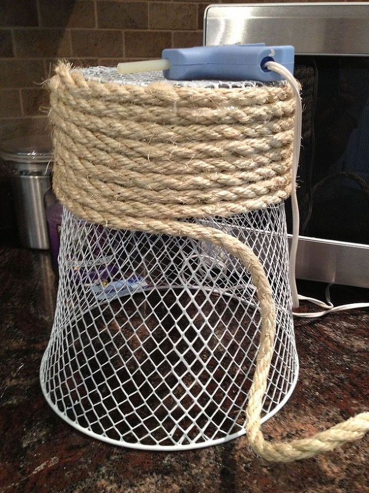 Basket wrapped with a rope, as a trash or storage basket / waste bas ...