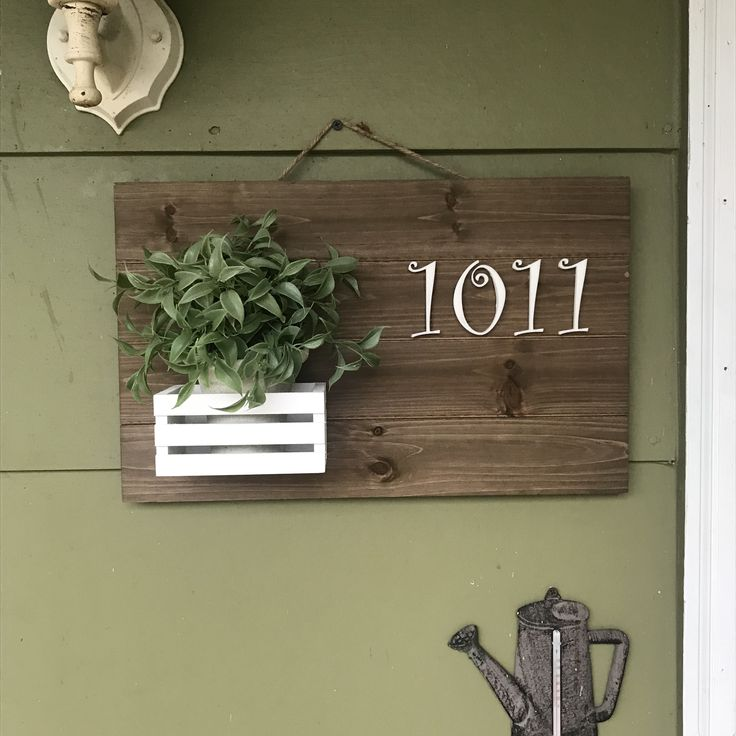 Pallet hanger, crate, and plant from Michaels; 3D printed address numbers