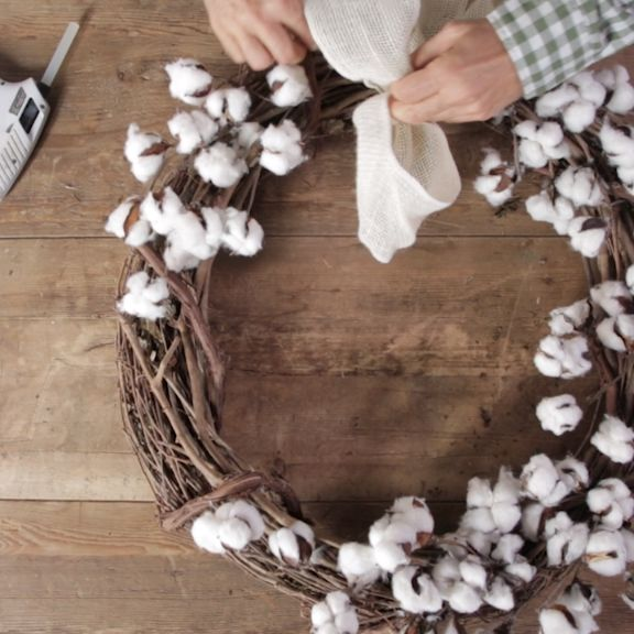 Add modern farmhouse style to your fall front door with a homemade cotton wreath...