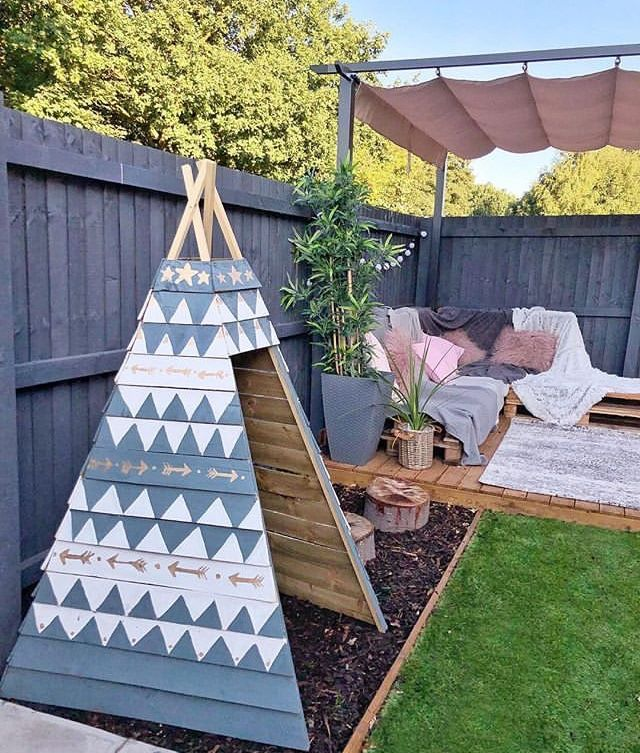 Kids wood teepee for outdoors. Outside kid play ideas