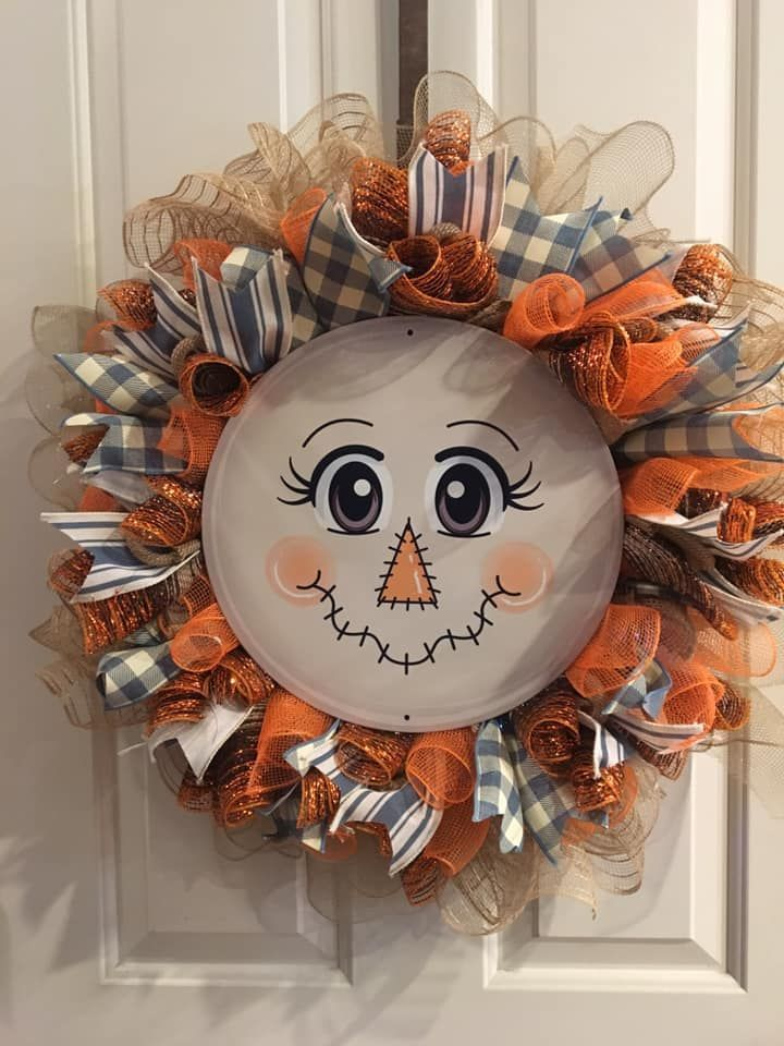 Get ready for fall! This adorable DIY scarecrow wreath was created by Sherrilynn...