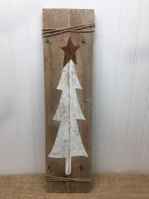 This simple rustic Christmas tree, complete with rusty star and twine adorn a fr...