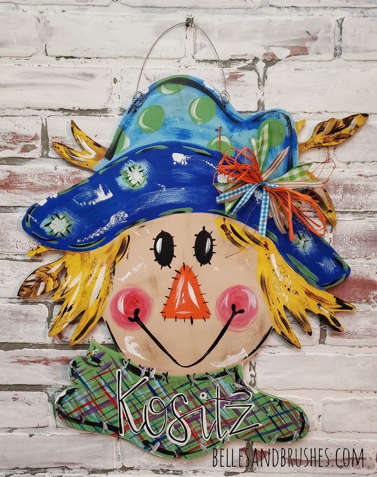 Scarecrow door hanger for Fall! I don't know that it will scare the crows away b...