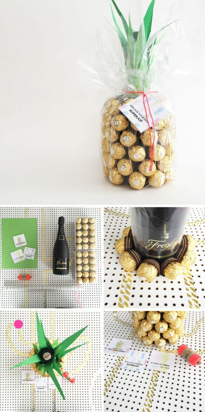 pineapple made of chocolates in golden wrappers, a black champagne bottle, some ...