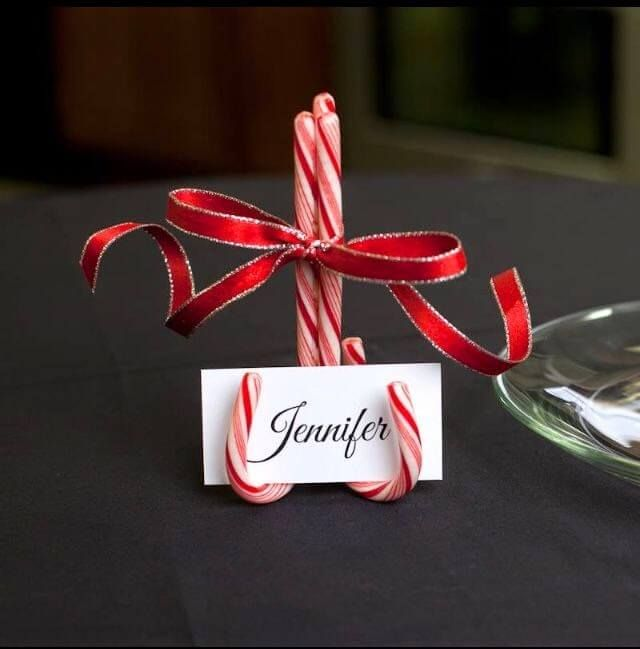 DIY table decoration ideas for Christmas, make seat card holder from candy canes