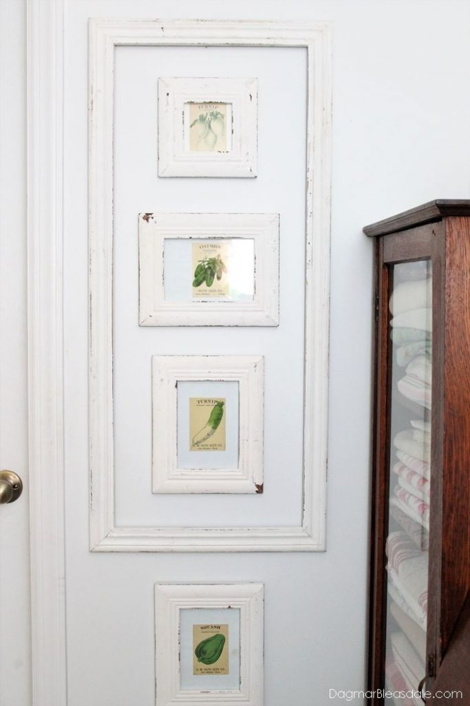Easy seed packets wall decor in our Blue Cottage. DIY unique wall decor. #DIY #c...