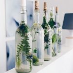 Bottles as candlestick // filled with floral deco #bottles # candlestick ...