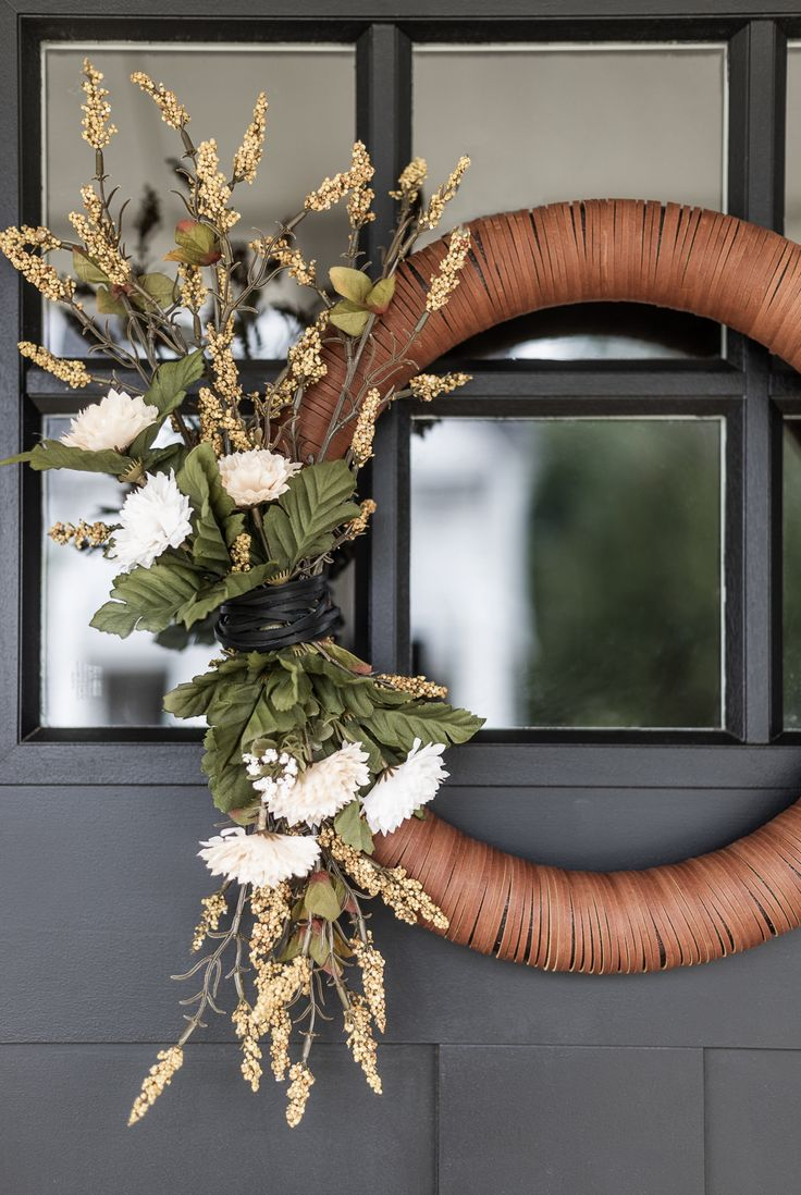Create a unique and neutral Modern Leather Fall Wreath with this easy to follow ...