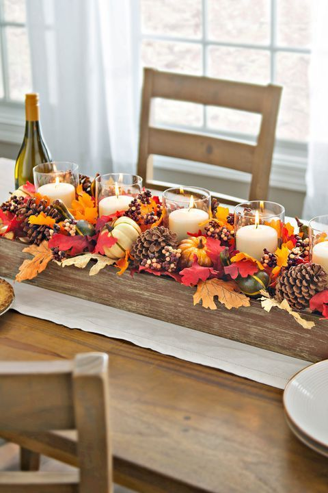 Creating an autumnal table piece can be very easy. Collect a few autumn leaves