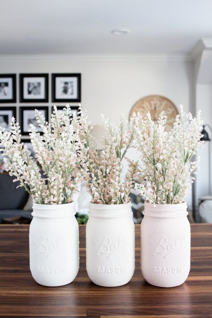 DIY pastel painted mason jar vases. Find this and many other up-cycle projects a...