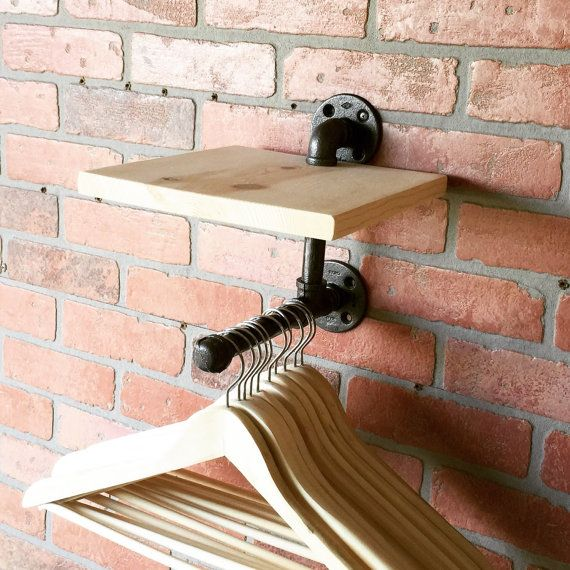 Industrial clothing rack with topsoil perfect for hats. This product is suitable for ...