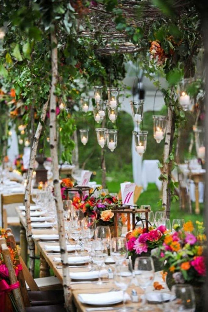 Lovely boho wedding decorations! Instead of using wax candles, consider using LE...