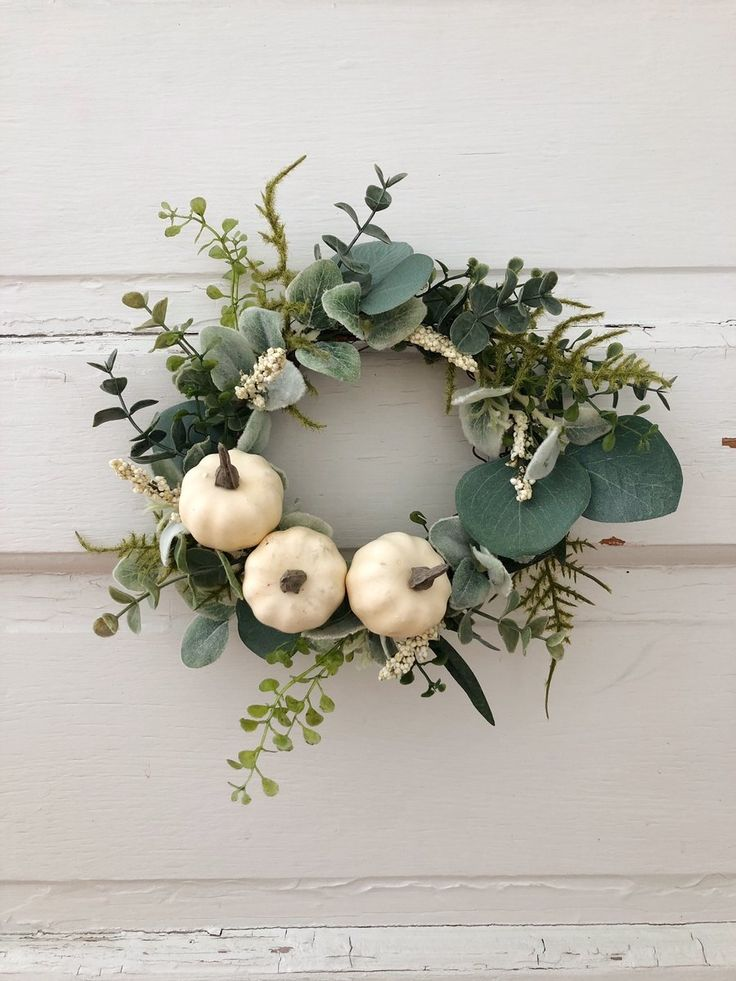 Neutral farmhouse friends! You can place this sweet pumpkin wreath just about an...