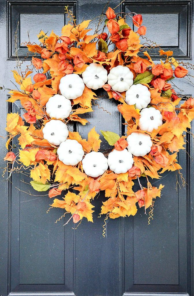 Put a big beautiful fall wreath on your front door. One that will get noticed! H...